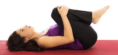 Knees to Chest Pose	Yoga Apanasana Pose	yoga-apanasana-pose.jpg